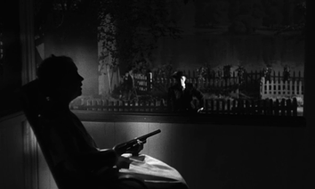 A lighting arrangement in The Night of the Hunter. Note the placement of the key light off the subject (Lillian Gish) to create a silhouette while illuminating Robert Mitchum in the background. This plays off the conventional association of light with good and darkness with evil.