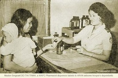 Master-Sergeant and pharmacist Do Thi Trinh, part of the WAFC, supplying medication to ARVN dependents