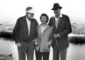 Photo of Ernest Hemingway, Bobbi Powell, and Gary Cooper during a hunting trip