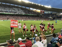 The Flames, the cheersquad for the St. George Illawarra Dragons, performing during an NRL match in 2018.