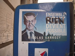 "A pro-Sarkozy sticker, after being defaced, in Paris, France. (Translation: ""Together, NOTHING is possible."")"