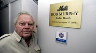 Murphy in front of the radio booth at Shea Stadium named in his honor. The radio booth at Citi Field is identically named.