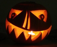 A pumpkin carved into a jack-o'-lantern for Halloween