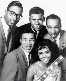 The Miracles in 1962, clockwise from top left: Bobby Rogers, Marv Tarplin, Ronald White, Claudette Robinson, and Smokey Robinson – Pete Moore had been drafted into the Army at the time this photo was taken.