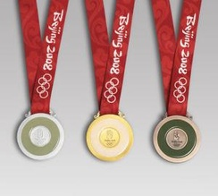 The reverse side of the medals of the 2008 Summer Olympics: silver (left), gold (center), bronze (right). Each medal has a ring of jade.