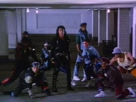 "Jackson and background dancers in ""Bad""'s music video. The music video was heavily influenced by the 1961 film West Side Story."