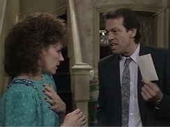 A scene from EastEnders on Christmas Day 1986, watched by 30.15 million viewers. The story, in which Den Watts (Leslie Grantham) served his wife Angie (Anita Dobson) with divorce papers, was the highest-rated soap episode in British history, and the highest-rated program in the UK during the 1980s. Only the 1966 World Cup Final and the funeral of Princess Diana rank higher in the all time ratings.[55]