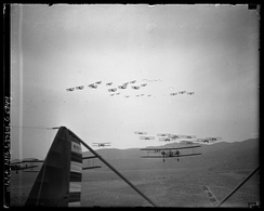 Formations of Keystone LB-7s (lower) and Boeing P-12s (upper) on aerial maneuvers over Burbank, California, 1930