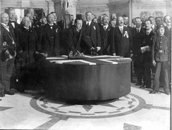 "Edward Carson signing the Solemn League and Covenant in 1912, declaring opposition to Home Rule ""using all means which may be found necessary"""