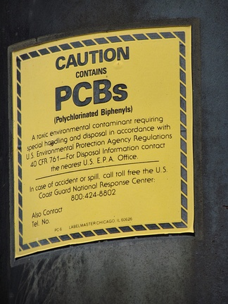 PCB warning label on a power transformer known to contain PCBs.