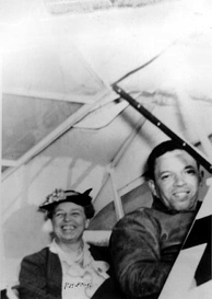 "Roosevelt flying with Tuskegee Airman Charles ""Chief"" Anderson in March 1941"