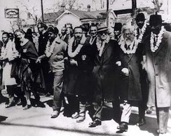 "The third Selma Civil Rights March frontline. From far left: John Lewis, an unidentified nun; Ralph Abernathy; Martin Luther King, Jr.; Ralph Bunche; Rabbi Abraham Joshua Heschel; Frederick Douglas Reese. Second row: Between Martin Luther King, Jr. and Ralph Bunche is Rabbi Maurice Davis. Heschel later wrote, ""When I marched in Selma, my feet were praying."" Joseph Ellwanger is standing in the second row behind the nun."