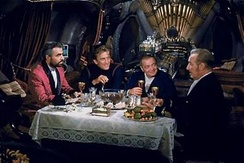 Dinner aboard the Nautilus. From left to right: James Mason, Kirk Douglas, Peter Lorre, and Paul Lukas.