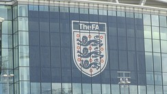 Logo of the governing body of English football, the FA, as displayed on the exterior of Wembley Stadium