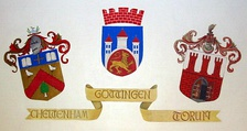Coats of arms of twin towns of Cheltenham, Göttingen and Toruń
