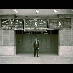 Owner Eddie Shore at the Eastern States Coliseum with the Springfield Indians' championship banners.