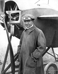 Charles Weymann standing in front of his Nieuport monoplane
