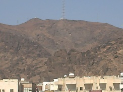 Ravine of Mount Uhud (bifurcated mount just seen below in line of tower structure) where Muhammed was taken for rest after injury