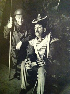 stage shot of two actors in mid scene dressed in historic war costumes