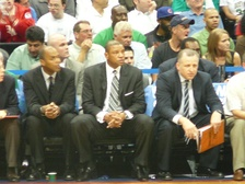 Rivers (center) sits on the sidelines with assistant coaches Tom Thibodeau (right) and Armond Hill (left) in Game 4 of the 2008 NBA Playoffs against the Atlanta Hawks.