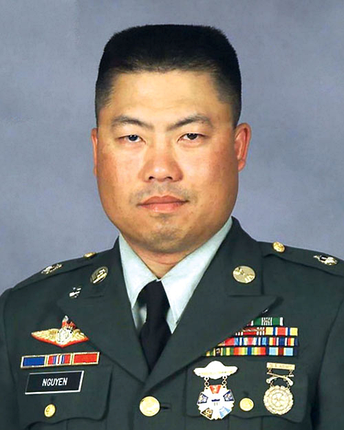 SFC Nguyen (KIA 2006) wearing his Army Interservice Competition Badge (gold) (left) and Army EIC Pistol Shot Badge (bronze) (right) on the U.S. Army Service Uniform
