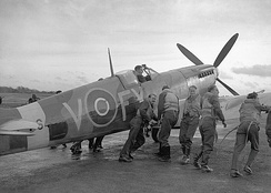 Pilots of 611 West Lancashire Squadron pushing an early Spitfire Mark IXb at Biggin Hill in late 1942