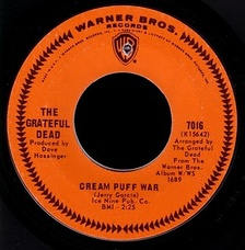 """Cream Puff War"" (1967), the first single by the Grateful Dead. The orange label with chevron border was used on Warner Bros.' American 45s for much of the 1960s."