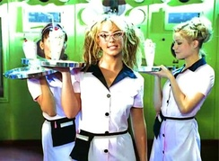 "Spears and actress Melissa Joan Hart (right) dressed as waitresses of a dance club in the music video for ""(You Drive Me) Crazy""."