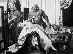 Paul Wegener (as the Golem) and Lyda Salmonova (as Jessica), in the 1915 German, partially lost horror film Der Golem.