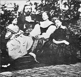 Théophile Gautier, his wife Ernestina Grisi-Gautier and their daughters Estelle and Judith. Photograph taken around 1857.