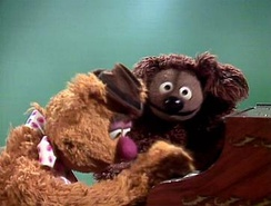 "Fozzie Bear (left) and Rowlf the Dog (right) perform ""English Country Garden"" on episode 218 of The Muppet Show"